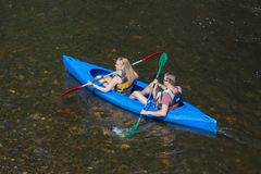 Girl and boy in kayak at river Ourthe near La Roche-en-Ardenne, Belgium Royalty Free Stock Image