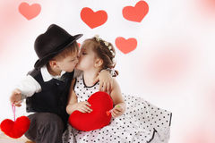 Girl and boy kissing and holding hearts Royalty Free Stock Image