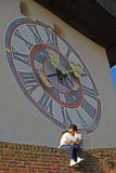 Girl and boy are kissing nearly city clock tower Royalty Free Stock Photo