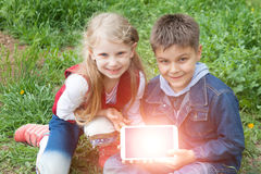 Girl and boy with laptop Royalty Free Stock Images