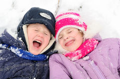 Girl and boy laughing at snowy winter Stock Photos
