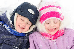 Girl and boy laughing at snowy winter Stock Photo