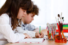 Girl and boy learning Royalty Free Stock Image