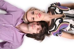 Girl and boy lie on white Stock Photo