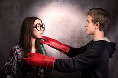 Girl and boy with  lobster claw. Difficult teenager`s relationship concept Stock Photos