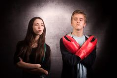 Girl and boy with lobster claw. Girl and boy with  lobster claw. Difficult teenager`s relationship concept Stock Photo