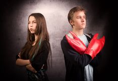 Girl and boy with  lobster claw. Difficult teenager`s relationship concept. Studio shot on grey background Royalty Free Stock Photography