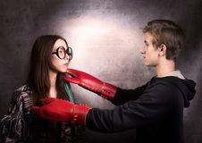 Girl and boy with  lobster claw. Difficult teenager`s relationship concept. Studio shot Royalty Free Stock Photos