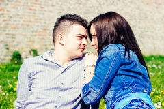 Girl and boy looking each other in the eye. Couple date royalty free stock photo