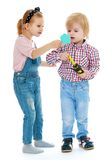 Girl and boy looking in the mirror. Stock Images
