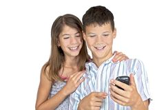 Girl & boy looking mobile phone Stock Photo