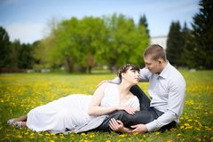 Girl and boy lying on the grass Royalty Free Stock Photo