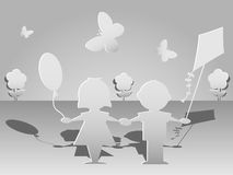 Cut paper silhouettes of children Royalty Free Stock Photos