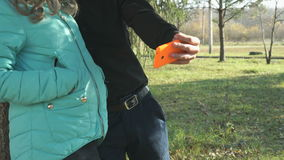 Girl and boy making selfie using a cellphone stock video