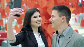 Girl and boy are making selfies stock video