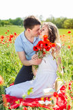 Girl and boy on a meadow full of poppies Royalty Free Stock Photo