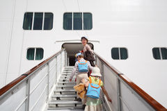 Girl and boy with mother enter in passenger liner Royalty Free Stock Photography
