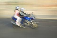 Girl and boy on motorcycle riding through Nice, France Stock Photography