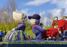 Girl and boy in native clothes from flowers. Flower parade Stock Image