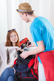 Girl and boy packing a backpack Royalty Free Stock Images