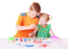 Girl and boy in paint Royalty Free Stock Photography