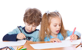 Girl and boy are painting Royalty Free Stock Photos