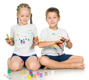 Girl and boy are painting Stock Photo