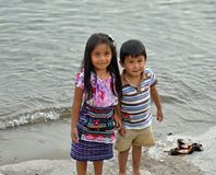 Girl and Boy 1. PANANACHEL GUATEMALA - JULY 4, 2015: An unknown Guatemalan prescheool aged girl and her younger brother play along the banks of Lake Atitlan stock images