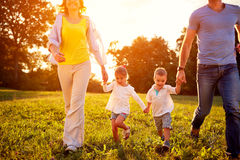 Girl and boy with parents outdoor royalty free stock photo