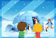 A girl and boy with penguines. Illustration of a girl and boy with penguines in snow fall Stock Image
