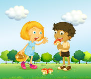 A girl and a boy picking up mushrooms Stock Photo