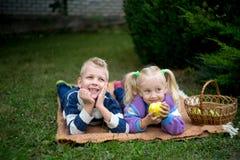 Girl boy picnic stock image