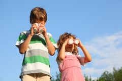 Girl and boy play with small bottles Royalty Free Stock Photography