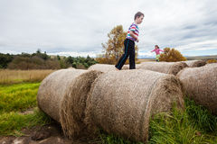 Girl Boy Playing Farm Bales Stock Photos