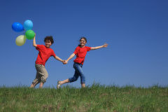 Girl and boy playing outdoor stock image