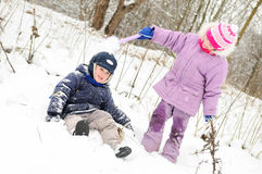 Girl and boy playing at snowy winter Royalty Free Stock Images