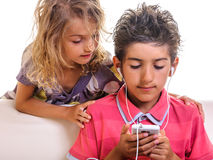Girl and boy playing video games cellphone Stock Photos