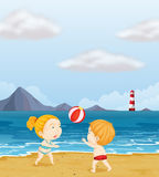 A girl and a boy playing volleyball at the beach Royalty Free Stock Image