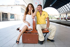 A girl and a boy on railway station Stock Photos