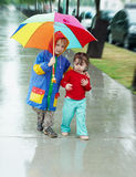 Girl and boy in the rain Royalty Free Stock Photos