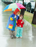 Girl and boy in the rain Stock Photo
