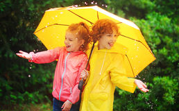 Girl and boy during a rain under one umbrella. Royalty Free Stock Image