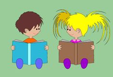 The girl and the boy read books Stock Photo
