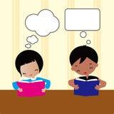 Girl and boy reading Stock Photos