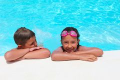 Girl and boy relaxing near  swimming pool Royalty Free Stock Images