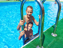 Girl and boy in resort swimming pool Stock Image