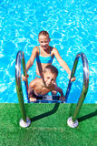 Girl and boy in resort swimming pool Royalty Free Stock Image