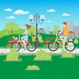 Girl and boy riding bicycles Royalty Free Stock Photography