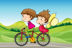 A girl and a boy riding in a bike Stock Photography