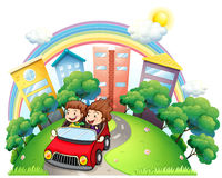 A girl and a boy riding at the car along the road Stock Images